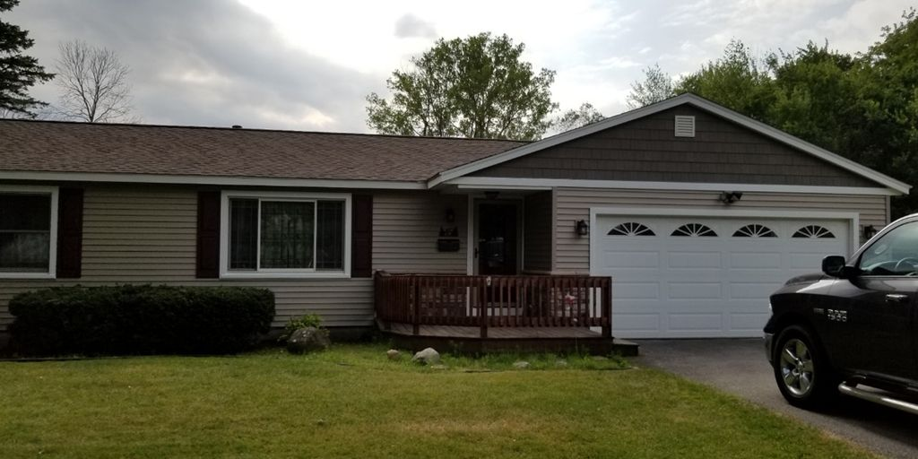 The project after photo showing how the front of the home looks now after installing a beautiful new roof and siding.